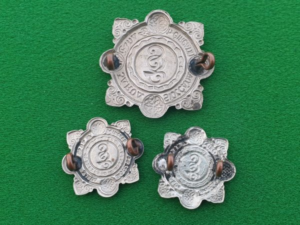 From the back you see that the badges have all been struck from a die. All lugs present on the three pieces.